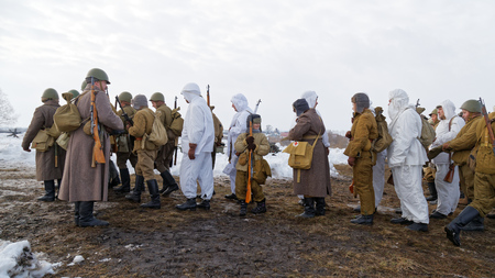 Ulyanovsk, Russia - February 25, 2017:  Group of Russian Soviet Armed soldiers, reenactors during reenactment of World War II battle. Military-historical festival Immortal feat