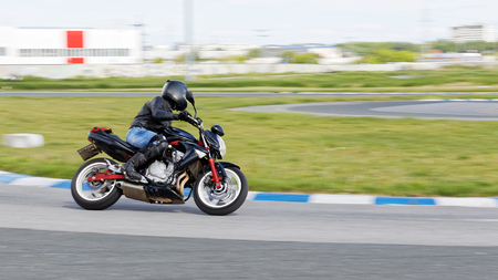 A motorcycle racer makes a practice run on a sports track. Motion blur. Stock Photo - 80391147