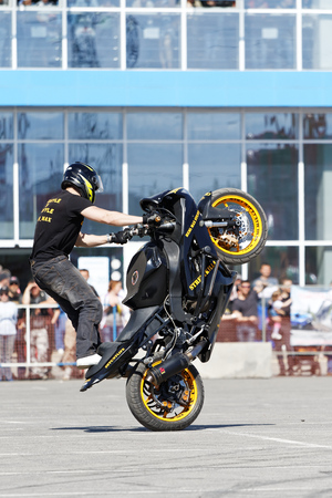 Ulyanovsk, Russia - May 20, 2017. A motorcycle rider make wheelie on the bike.