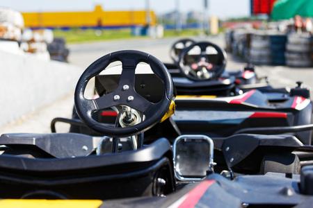 Kart cars parked next to track in anticipation of drivers. Shallow focus. Фото со стока