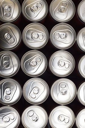 Group of aluminum cans with beer or soda. Top view.