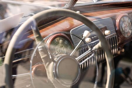 Old cabin, console and steering wheel in a vintage retro car. Retro toning vintage style image.
