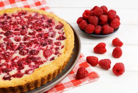Closeup homemade raspberry pie with yogurt filling. Shallow focus.