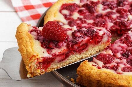 Closeup piece of homemade raspberry pie with yogurt filling. Shallow focus.