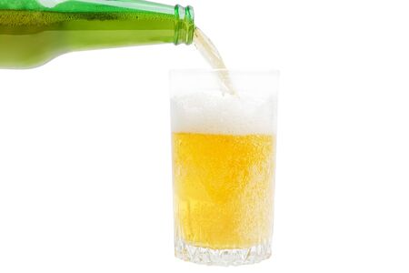 Closeup image of pouring beer from bottle into glass isolated on white Stock fotó