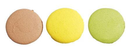 Closeup three different colored macaroons isolated on white.