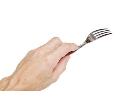 Humans left hand holding a silver fork isolated on white.