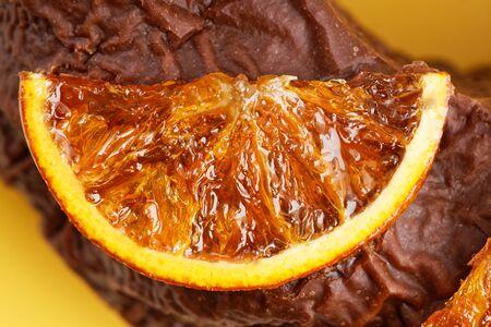 Closeup caramelized orange slice on homemade chocolate cake.