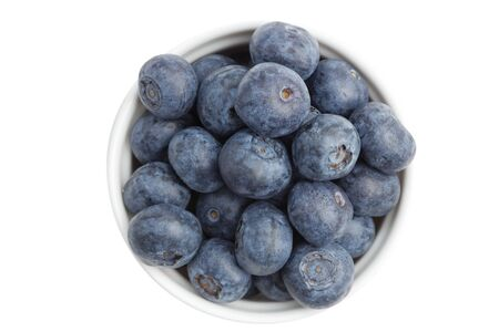 Blueberries in the white ceamic bowl isolated on white.