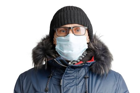 Closeup portrait of a man in winter clothes and a hat, glasses and a protective mask. Isolated on white.