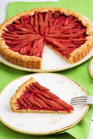 Homemade rhubarb and strawberry pie on white wooden table. Shallow focus. Archivio Fotografico