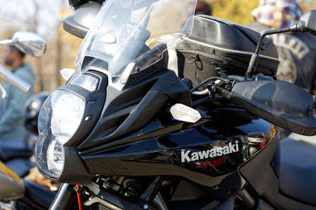 Ulyanovsk, Russia - October 03, 2020. Close-up side view of motorcycle Kawasaki Versys with text logo.