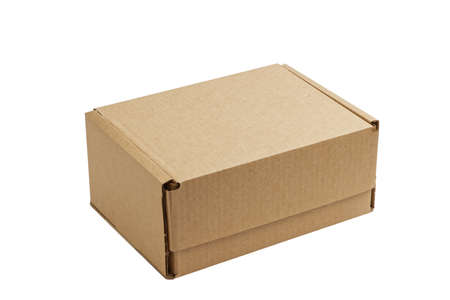 Closed brown cardboard box without label. Box for parcel, delivery or packaging isolated on white background.