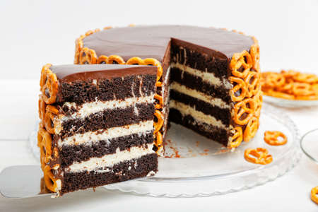 Closeup Piece of Homemade Chocolate Cake Decorated with Cookies. Shallow focus. Archivio Fotografico