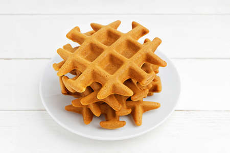 Stack of homemade soft belgian waffles on white wooden table. Shallow focus. 스톡 콘텐츠