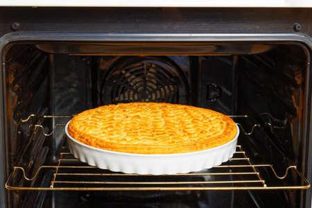 Closeup homemade gooseberry lemon pie baked in a home oven. Shallow focus.