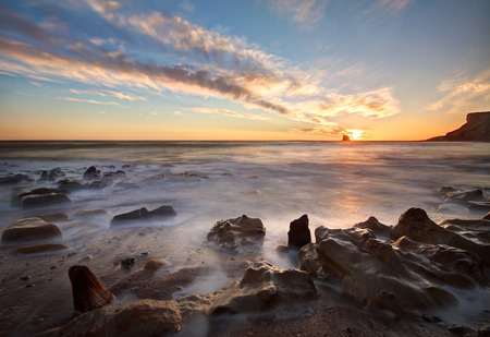 whitby: Sunrise over Saltwick Bay, Whitby, North Yorkshire