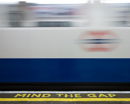 gaps: Blurred London Underground train entering station platform