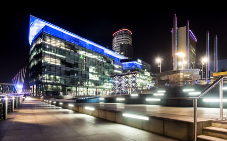 bbc: Manchester, UK - February 14, 2015: Salford Quays, Manchester. Night view of the BBC and ITV studio complex at Media City, Salford.