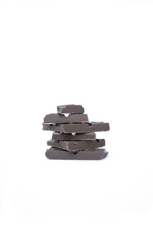 A tower of bitter chocolate pieces Stock Photo