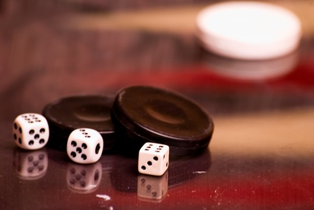 checkers and dice for the game on the board photo