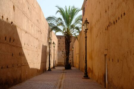 Morocco Marrakesh red city medina street photo, ramparts of beaten clay