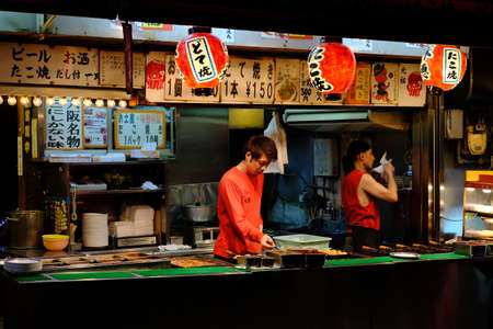 Osaka Japan - Street food restaurants in Dotonbori Street