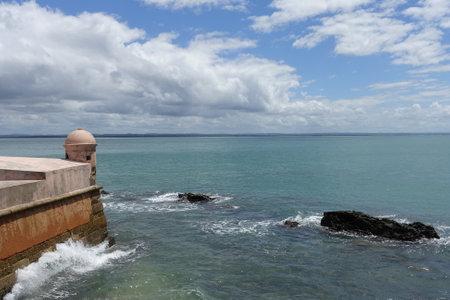 Brazil Morro de Sao Paulo - Outlook in Ponta do Facho fortress wall and surging billows