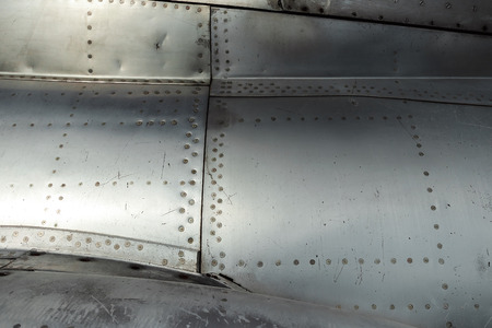 Texture, Aluminum fuselage and rivets on an old plane. Old technologies.