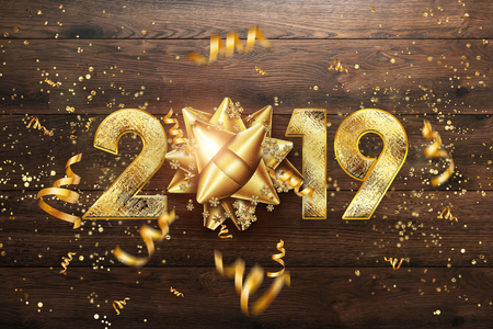 Creative background, 2019 Happy new year. Gold Numbers Design of greeting card of. Gold Shining Pattern. Happy New Year Banner with 2019 Numbers on brown wooden background. Confetti, copy space.