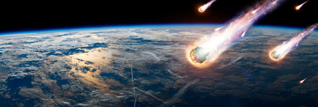 A comet, an asteroid, a meteorite glows, enters the earth's atmosphere. Attack of the meteorite. Meteor Rain. Kameta tail. End of the world. Stock Photo