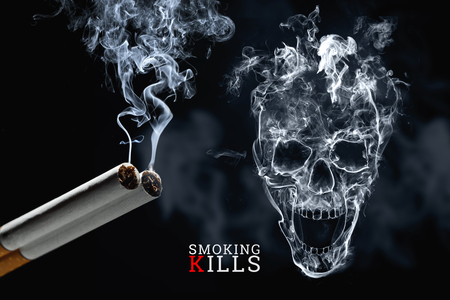 Skull from cigarette smoke on a black background, cigarettes close up. Creative background. The concept of smoking kills, nicatine poisons, cancer from smoking, stop smoking. 版權商用圖片
