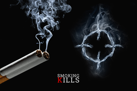 Cigarettes close-up on a black background, cigarette smoke, a target. Creative background. The concept of smoking kills, nicatine poisons, cancer from smoking, stop smoking. Copy space. Stok Fotoğraf