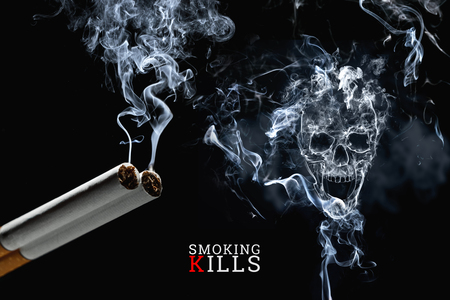 Skull from cigarette smoke on a black background, cigarettes close up. Creative background. The concept of smoking kills, nicatine poisons, cancer from smoking, stop smoking. Фото со стока