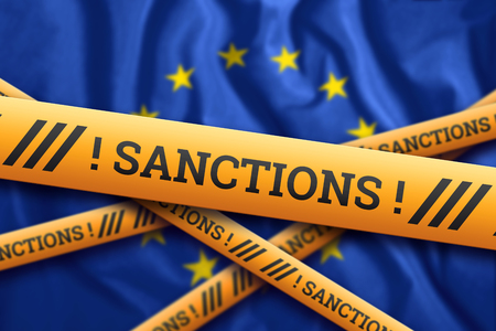 Creative background, the inscription on the flag of the European Union, sanctions, yellow fencing tape. The concept of sanctions, policies, conditions, requirements. 3d rendering, 3d illustration Фото со стока