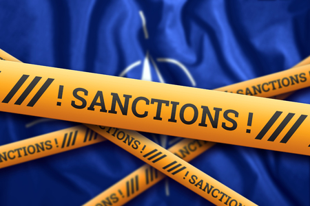 Creative background, the inscription on the NATO flag, sanctions, yellow fencing tape. The concept of sanctions, policies, conditions, requirements, trade wars. 3d rendering, 3d illustration Фото со стока