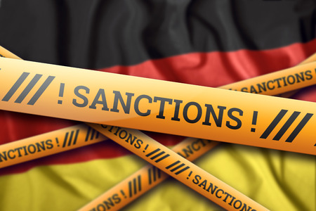 Creative background, the inscription on the flag of Germany, sanctions, yellow fencing tape. The concept of sanctions, policies, conditions, requirements, trade wars. 3d rendering, 3d illustration Фото со стока