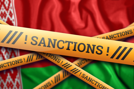 Creative background, the inscription on the flag of Belarus, sanctions, yellow protective tape. The concept of sanctions, policies, conditions, requirements, trade wars. 3d rendering, 3d illustration Фото со стока