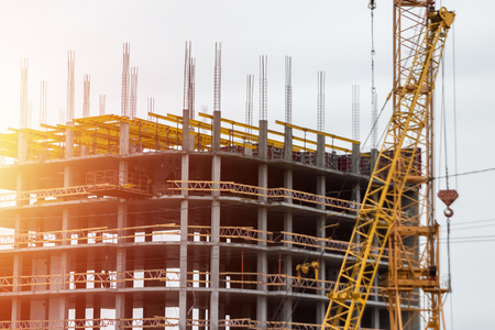 Building construction on monolithic technology. Construction of the building. Concrete frame of the building. Stock Photo