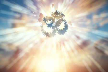 Symbol of Hinduism on the background of a beautiful sunset. The concept of religion, hope, faith, a symbol of freedom.