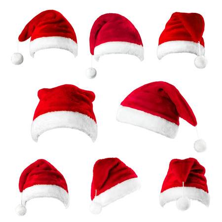 Set of red Santa Claus hats isolated on white background Reklamní fotografie