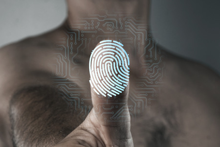 Scanning a fingerprint for identification. The concept of security system, the technology of scanning a fingerprint.