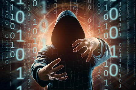 The man in the hood, the hacker, the hacker attack, the silhouette of the man, the hands are pushed in front, threatening. mixed media. The concept of sudden attack, cryptography, data security.