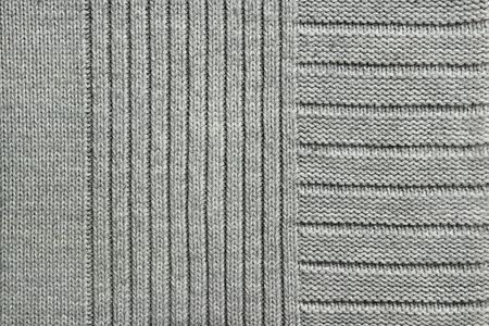 Texture of gray knitted fabric, close-up, top view 免版税图像