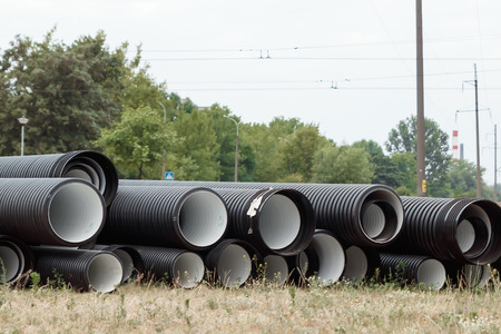 Pipes of corrugated plastic on the construction site. Construction works.