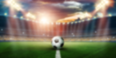 Blurred background, Stadium in lights and flashes, football field. Concept sports background, football, night stadium.