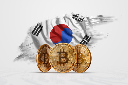 Crypto currency, gold coin BITCOIN BTC. Coin bitcoin against the background of the flag of South Korea. The concept a new currency, Blockchain Technology , a token. Stock Photo