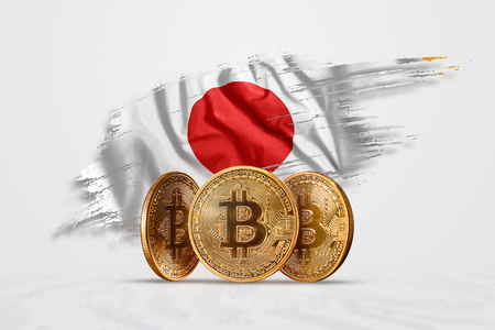 Crypto currency, gold coin BITCOIN BTC. Coin bitcoin against the background of the flag of Japan. The concept a new currency, Blockchain Technology , a token.