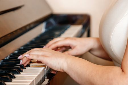 Female hands I play the piano, close-up. Musician, creativity. 写真素材