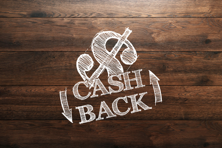 Inscription Cash Back, an image of the emblem on a wooden background. Icon, A symbol of cash back. The concept of business, finance.